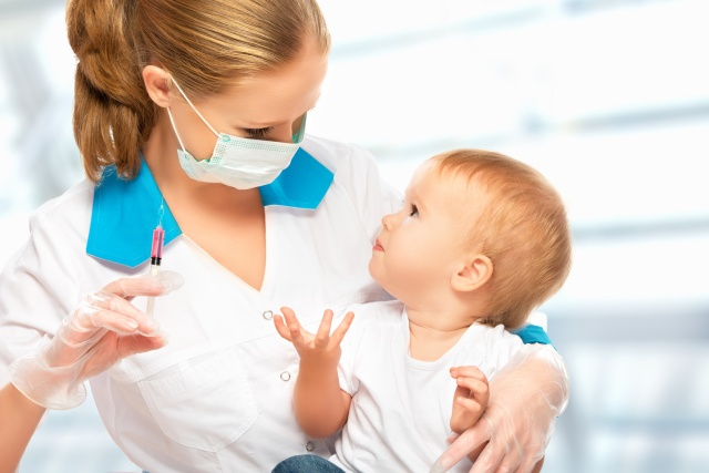 doctor does injection child vaccination baby